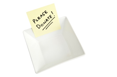 A white bowl with a note asking people to Please Donate Stock Photo - 9321989