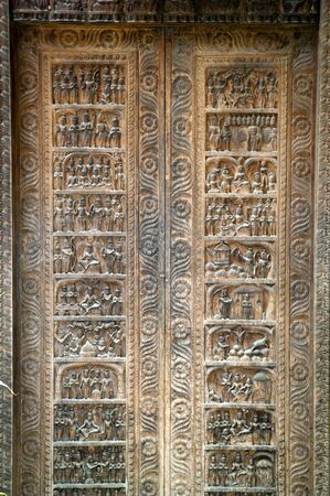 Intricate ancient doorway with wooden carvings photo