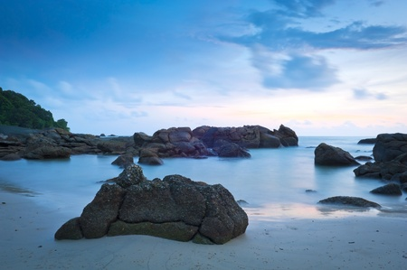 langkawi island: Time-lapse of beach at dusk with rocks