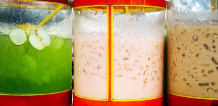 langkawi island: Large containers of colourful drink at a market stall
