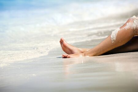 Womans legs on beautiful tropical beach with bright sand Stock Photo - 10203180