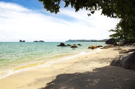 langkawi island: Tropical beach and coastline with waves lapping Stock Photo