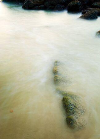 Time-lapse rocks pools at sunset photo