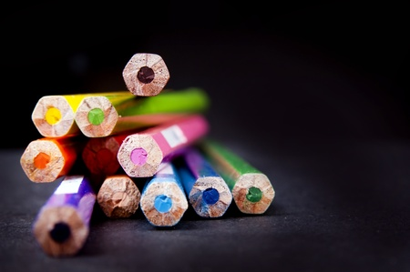 red pencil: Ends of used pencils in a stack in shallow focus