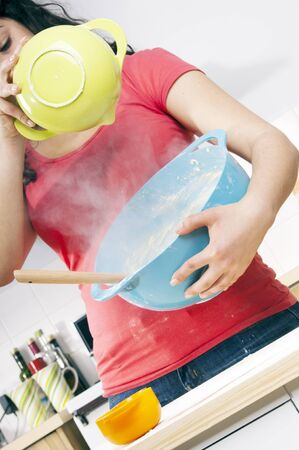 Series of a woman cooking in the kitchen with bright bowls Stock Photo - 10842783