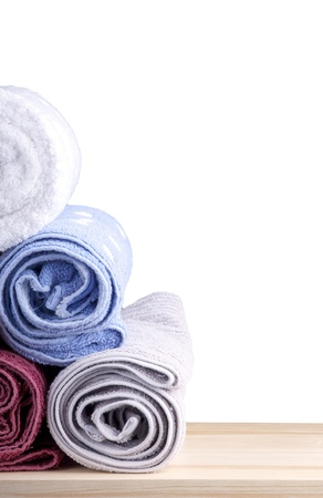 kitchen towel: Freshly washed rolled towels isolated on white