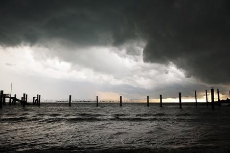 Huge black storm clouds gather photo