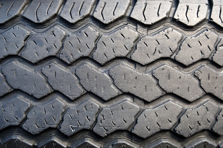 Tread patterns on old worn car tyres photo