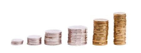 Set of Australian coin currency in stacks, including 5, 10, 20 and 50 cent coins, plus 1 and two dollars, isolated on white photo