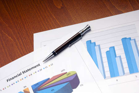 Business and finance concept with graphs and charts photo
