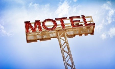 Classic motel sign against blue sky photo