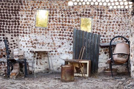 Interior of an old home built from tin cans with old furniture photo