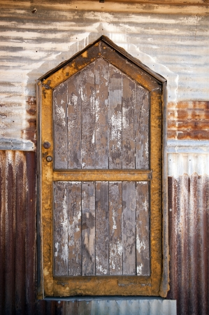 Old door made from wood with metal surrounds photo
