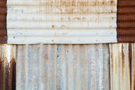 Rusted metal background of corrugated iron and tin with rivets photo