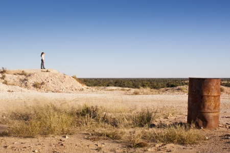 mining town: Young woman tourist in rural Australia at an opal mining site