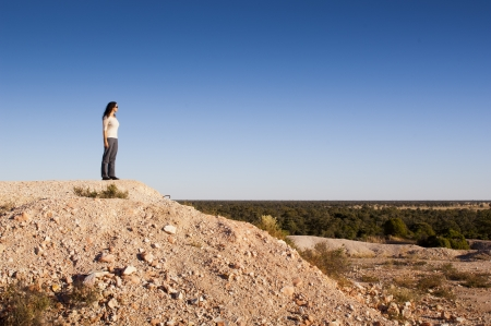 australia landscape: Young woman tourist in rural Australia at an opal mining site