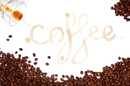Coffee written as a word in coffee stains with coffee beans around isolated on white photo