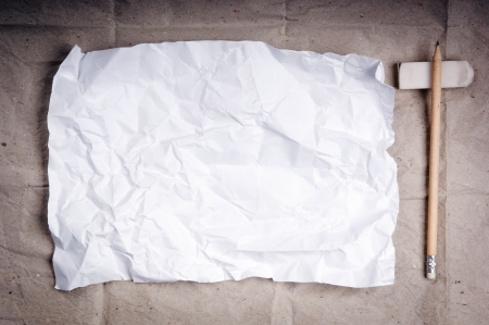Writing concept - crumpled up paper wads with a sheet of white paper and pencil Stock Photo - 14437757