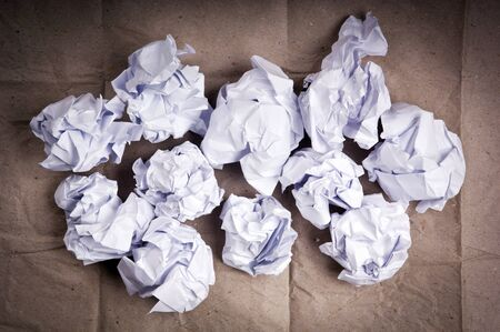 screwed: Crumpled up paper balls of white paper Stock Photo