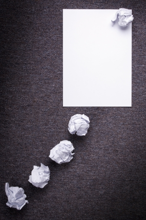 attempts: Crumpled paper with a thought balloon concept and crumpled paper attempts leading to it Stock Photo