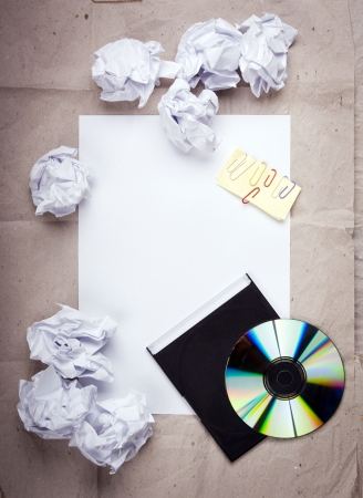crumpled sheet: Creative work background with crumpled up paper, office objects and room for text