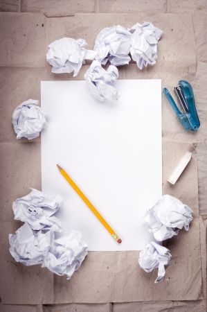 Creative work background with crumpled up paper, office objects and room for text photo