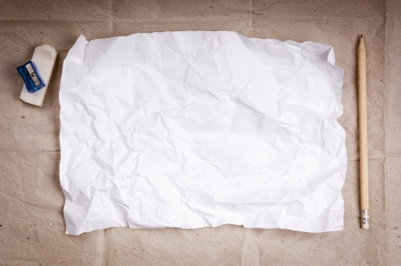 writers block: Writing concept - crumpled up paper wads with a sheet of white paper and pencil