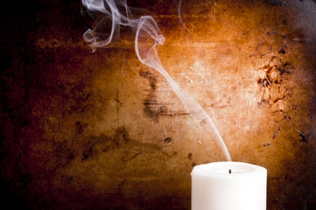 Smoke trails in smooth lines from a blown out candle with a vintage background photo