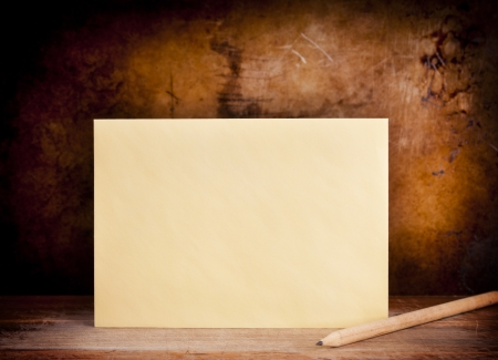 Vintage envelope background with pencil on a dark grunge background in shallow foucs photo