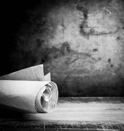 parchment scroll: Old paper parchment scroll rolled up with a vintage background with copy space Stock Photo