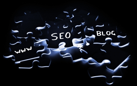 SEO internet concept with puzzle pieces photo