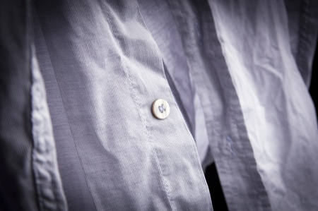Crumpled, creased un-ironed business shirt and buttons photo