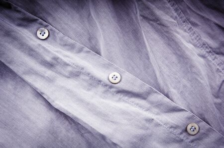 Crumpled, creased un-ironed business shirt and buttons
