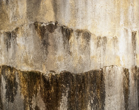 seeping: Concrete wall of a water tank with water seeping out as background texture