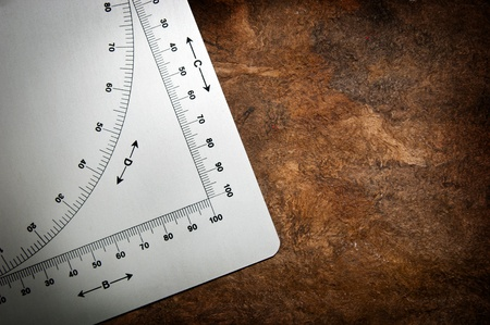 algebraic: Old protractor style measuring device with algebraic symbols and graph measurements Stock Photo