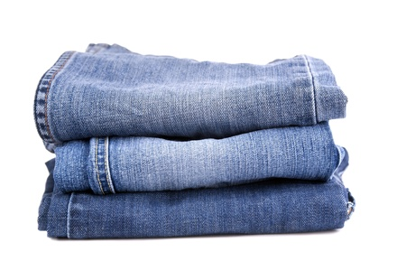 Blue jeans folded and stacked together, isolated on white Stock Photo - 16403618