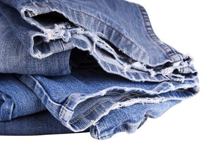 Torn blue jeans hem isolated on white photo