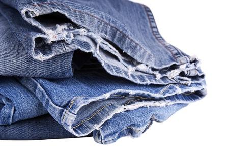 hem: Torn blue jeans hem isolated on white