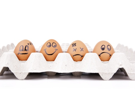 melodramatic: Eggs with human characteristics isolated on white as concept Stock Photo