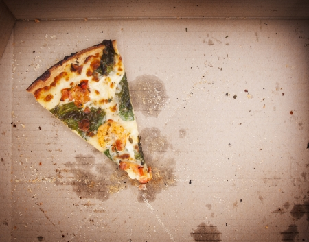 pizza slice: Pizza slice last one left in the pizza box Stock Photo