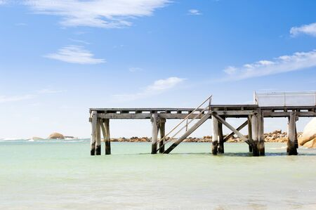 elliot: Jetty stretches out into the clear blue water in South Australia