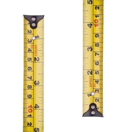 cintas metricas: Cinta métrica en milímetros y pulgadas aislado en blanco