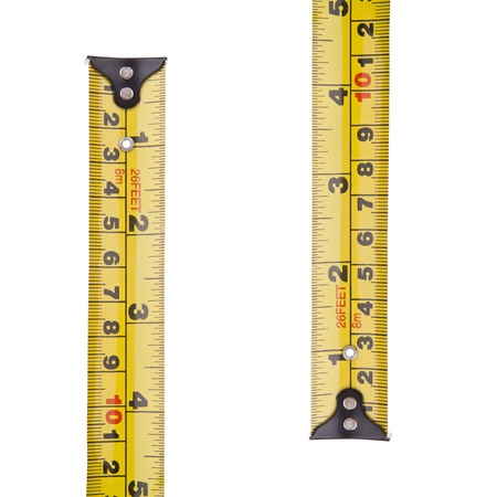 millimetres: Tape measure in millimetres and inches isolated on white Stock Photo