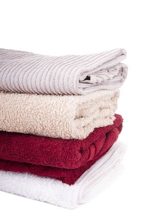 rags: Stack of fresh towels isolated on white