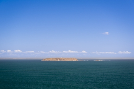 yorke: Remote Althorpe Islands off the coast of South Australia, with a lighthouse in view