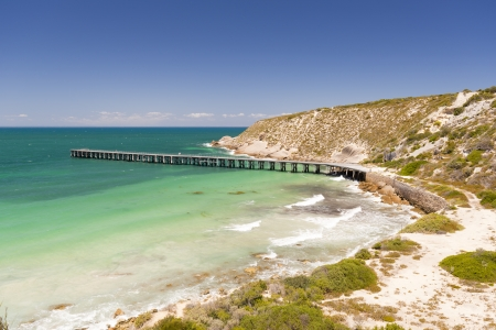Long wooden jetty stretches out into clear water at Stenhouse Bay, South Australia photo
