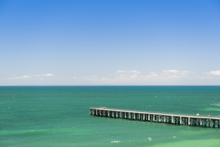yorke: Long wooden jetty stretches out into clear water at Stenhouse Bay, South Australia Stock Photo