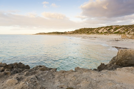 yorke: Deserted beach in a tranquil bay at sunset