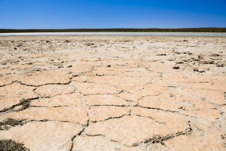badly: Earth badly cracked and broken under a hot sky Stock Photo