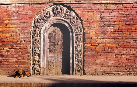 Intricate doorway of wood and stone in India photo